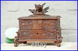 Antique Swiss black forest wood carved jewelry trinket box bird velvet